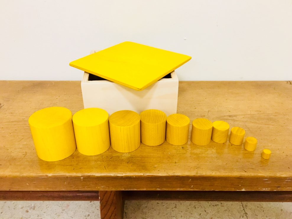 Yellow cylindrical blocks organized by height